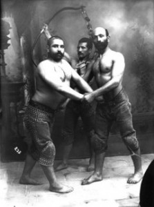 Studio Portrait of Three Traditional Persian Wrestlers sm